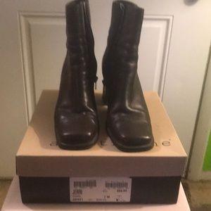 Brown zip-up boots.